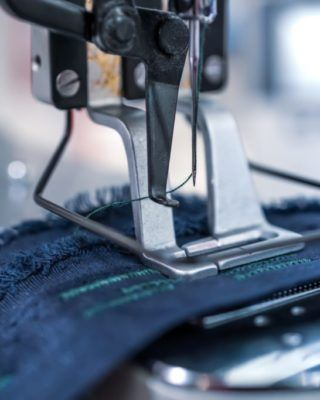Professional sewing machine close-up. Modern textile industry.
